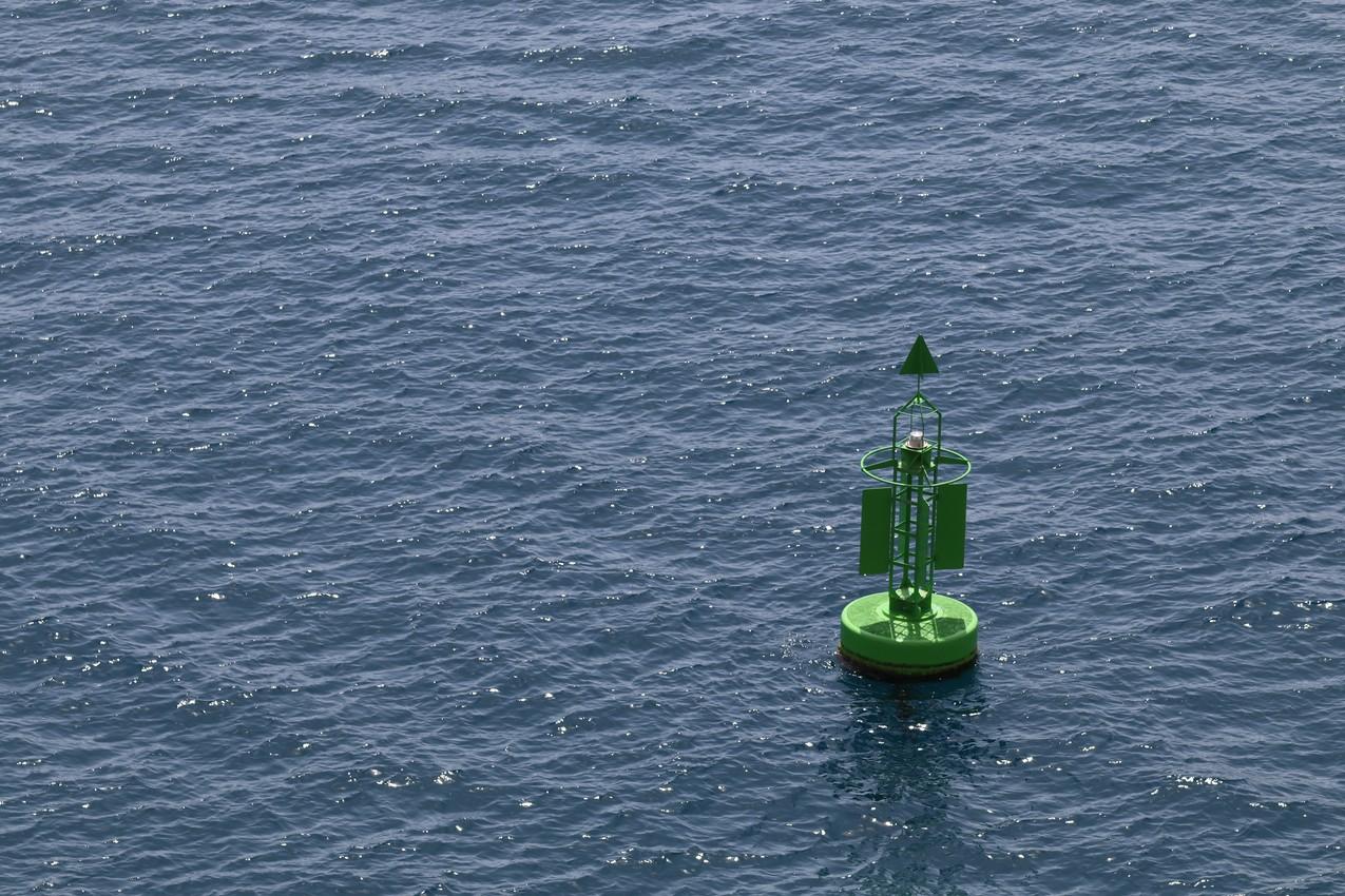 A Green Buoy in a Blue Sea
