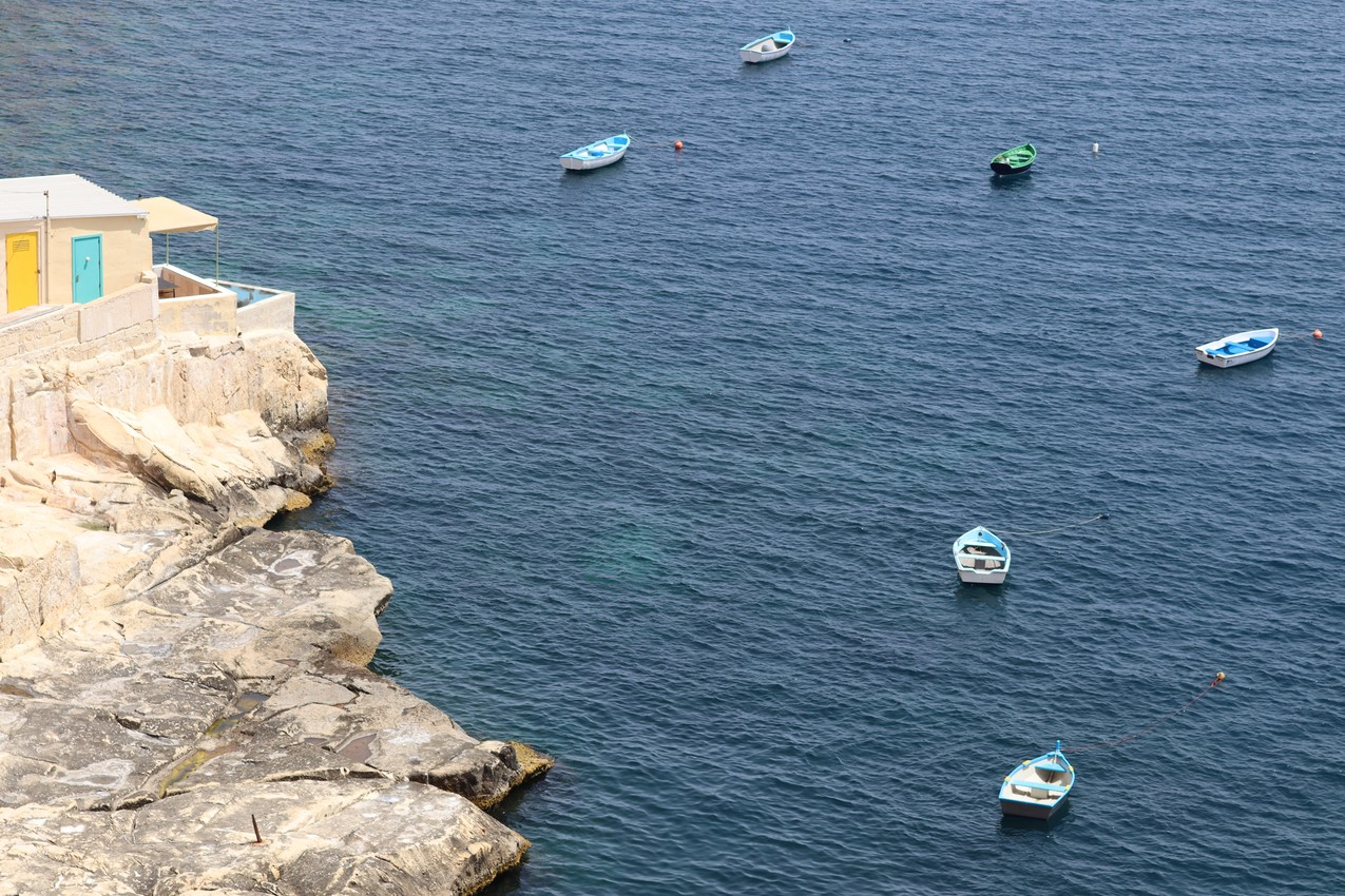 Dinghies in a Blue Sea